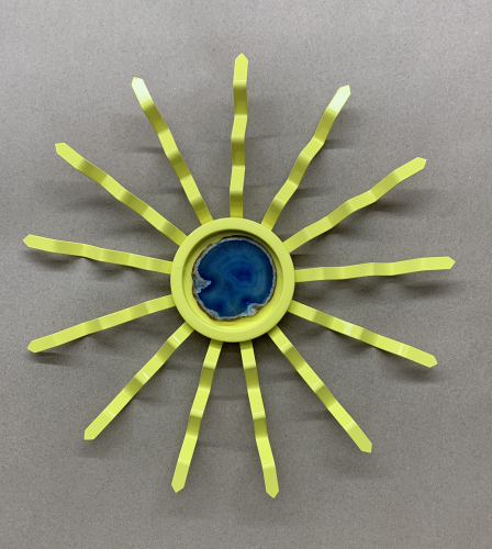 yellow sun with blue geode in center